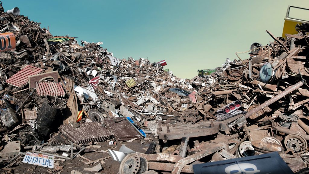 Can You Identify The Iconic Movie Car Parts Buried In This Junkyard? image